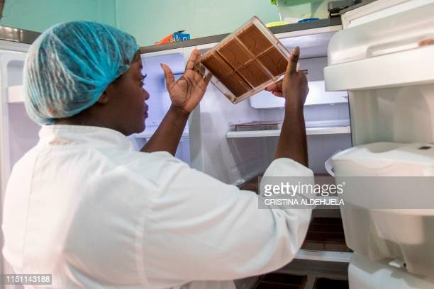 Ruth Amoah at her workplace in Accra on June 18 2019 checks if chocolate is ready to be removed from the mould Ruth Amoah came back from Britain in...