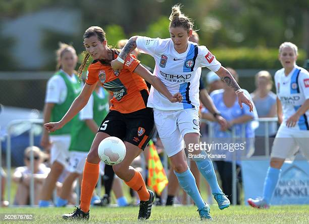 Ruth Blackburn of the Roar and Larissa Crummer of Melbourne City compete for the ball during the round 11 WLeague match between Brisbane Roar and...
