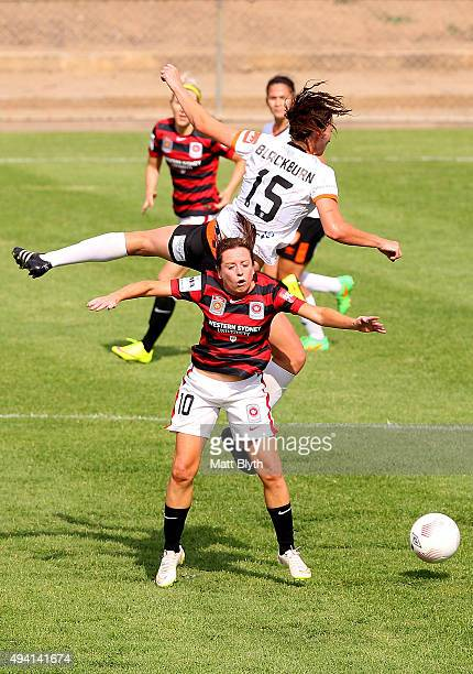 Ruth Blackburn of the Roar and Michelle Carney of the Wanderers compete for the ball during the round two WLeague match between Western Sydney and...