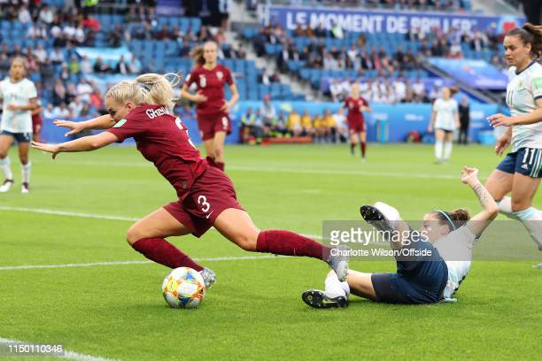 Ruth Bravo of Argentina fouls Alex Greenwood of England to give away a penalty during the 2019 FIFA Women's World Cup France group D match between...