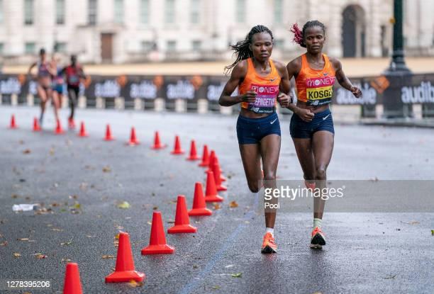 Ruth Chepngetich and Brigid Kosgei of Kenya compete in the Elite Women's Field during the 2020 Virgin Money London Marathon around St James on...