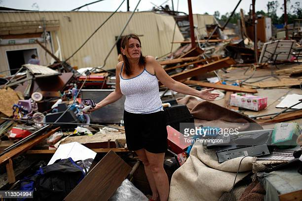 Ruth Cole digs through her destroyed business on May 1, 2011 in Tuscaloosa, Alabama. Cole had no insurance on her business or her home, which was...