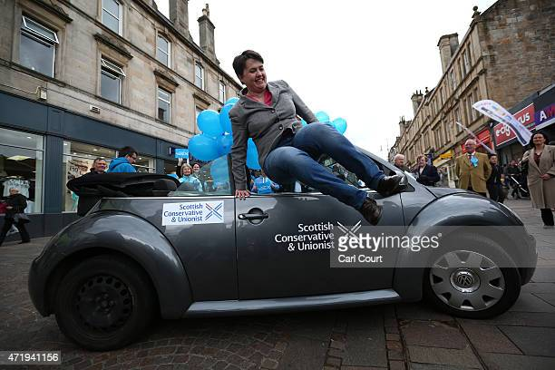 Ruth Davidson the leader of the Scottish Conservative Party jumps out of her car as she arrives at a campaign event on May 2 2015 in Hamilton...