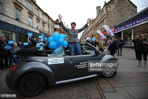 Ruth Davidson the leader of the Scottish Conservative Party waves from her car as she arrives at a campaign event on May 2 2015 in Hamilton Scotland...