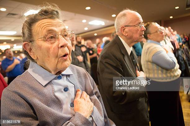 Ruth Douglas of Decatur Illinois recites the Pledge of Allegiance before US Senator Ted Cruz speaks at a campaign rally for the candidate on March 14...