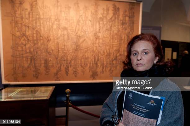 Ruth Dureghello President of the Jewish Community of Rome poses in front of the sketch for the internal gate of the Fosse Ardeatine created by Mirko...
