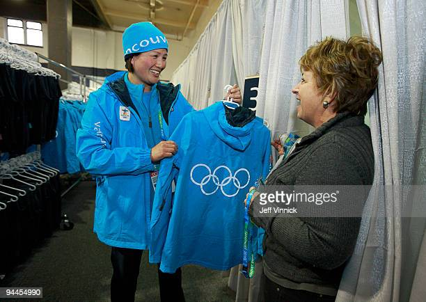 Ruth Grierson , a volunteer team leader at the Vancouver Village for the 2010 Winter Olympics is shown a uniform by Susan Weinreich at the Vancouver...