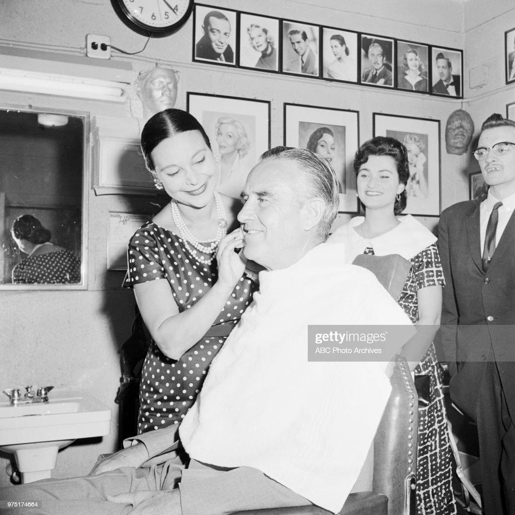 Ruth Hagy applying make-up to Governor of New York W Averell Harriman.