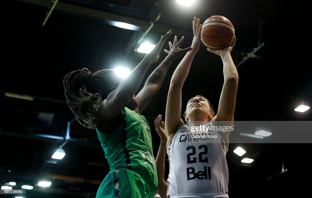 Ruth Hamblin of Canada attempts a trhow as she is challenged by Joice Rodrigues of Brazil during a match between Canada and Brazil as part of the FIBA Women's AmeriCup Semi Final at Obras Sanitarias Stadium on August 12, 2017 in Buenos Aires, Argentina.