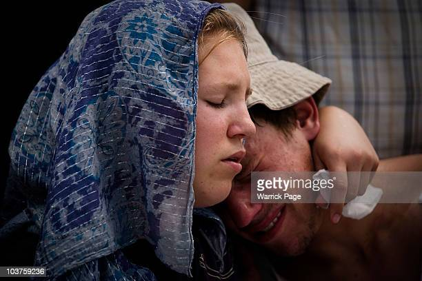 Ruth Imes left comforts her brother Ariel at their parents' memorial service who were shot dead by Palestinian Hamas militants yesterday evening...