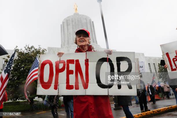 Ruth Jacobs of Oregon City holds a sign saying Open OR at the ReOpen Oregon Rally on May 2 2020 in Salem Oregon Demonstrators gathered at the state...