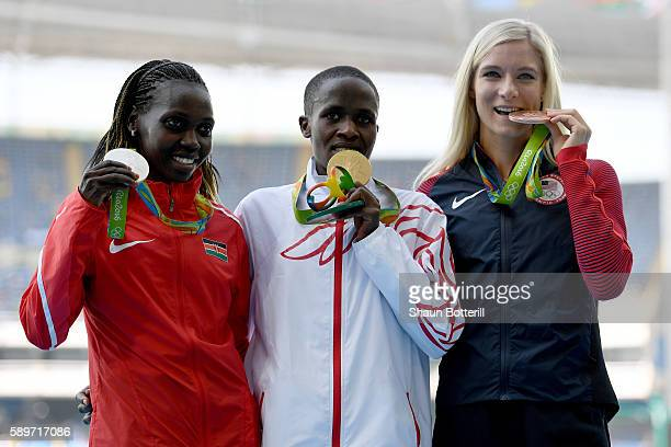 Ruth Jebet of Bahrain poses with the gold medal Hyvin Kiyeng Jepkemoi of Kenya silver medal and Emma Coburn of the United States bronze medal for the...