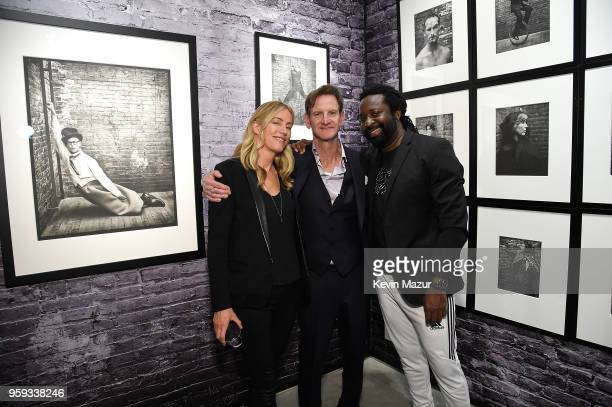 Ruth Levy Mark Seliger and Marlon James pose during a private viewing of Mark Seliger 'Photographs' at Chase Contemporary on May 16 2018 in New York...