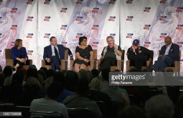 Ruth Marcus David Frum April Ryan Ambassador Joe Wilson James Carville and Michael Steele speak onstage during Politicon 2018 at Los Angeles...