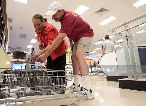 Ruth Medina and Howard Leffkin of Concord Mass try to decide on a dishwasher during a visit to the Sears store at Burlington Mall on August 13 2011...