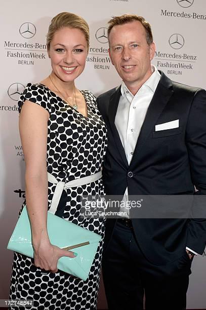 Ruth Moschner and Dirk Reichert attend the Laurel Show during the MercedesBenz Fashion Week Spring/Summer 2014 at Brandenburg Gate on July 4 2013 in...