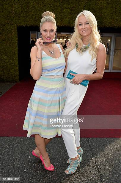 Ruth Moschner and Jenny Elvers attend the Kilian Kerner show during the MercedesBenz Fashion Week Spring/Summer 2015 at Erika Hess Eisstadion on July...
