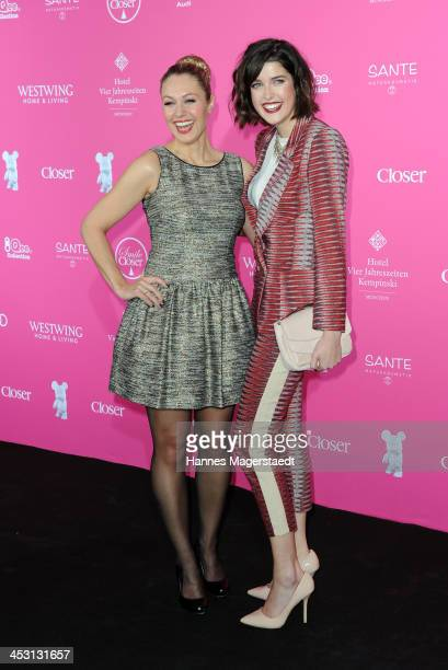 Ruth Moschner and model Marie Nasemann attends the Closer Charity Event SMILE at Hotel Vier Jahreszeiten on December 2 2013 in Munich Germany