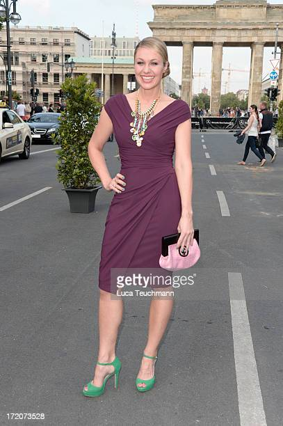 Ruth Moschner attends the MercedesBenz Fashion Week Berlin Spring/Summer 2014 Preview Show by Grazia at the Brandenburg Gate on July 1 2013 in Berlin...
