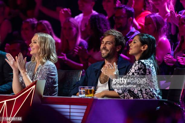 Ruth Moschner Max Giesinger and Collien UlmenFernandes during the first liveshow of The Masked Singer at Coloneum on June 27 2019 in Cologne Germany