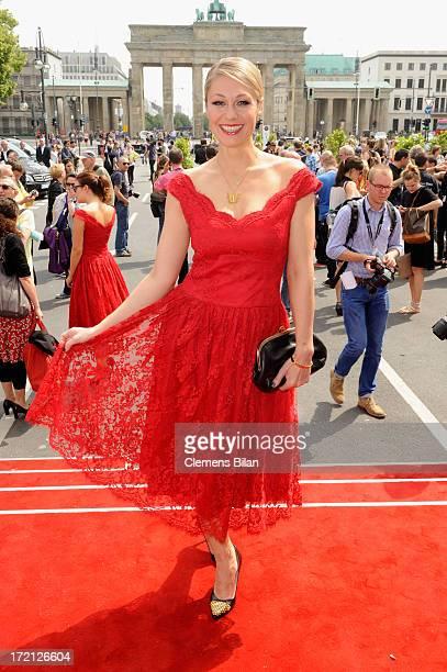 Ruth Moschner poses prior to the Lena Hoschek Show during MercedesBenz Fashion Week Spring/Summer 2014 at Brandenburg Gate on July 2 2013 in Berlin...