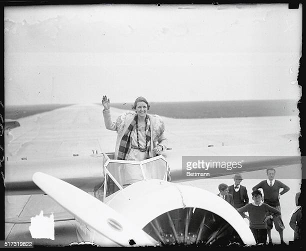 Ruth Nichols society girl and aviatrix waving from the cockpit of her Lockheed Vega monoplane just before she took it up on a test flight from Floyd...