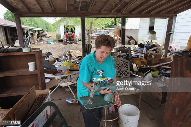 Ruth Pasloy rescues a vintage electric sewing machine from her flood-damaged home May 19, 2011 near Des Arc, Arkansas. The truck was nearly...