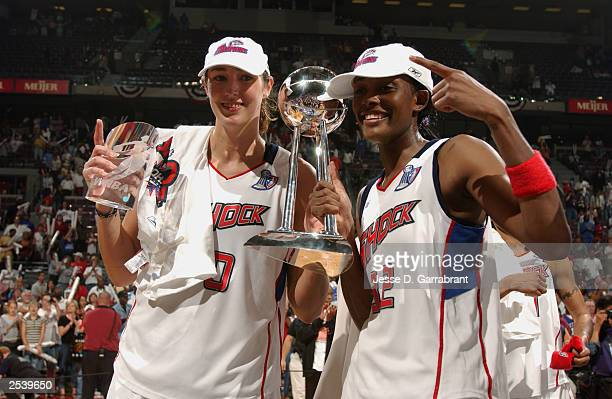 Ruth Riley and Swin Cash of the Detroit Shock celebrate after defeating the Los Angeles Sparks in Game three of the 2003 WNBA Finals on September 16...