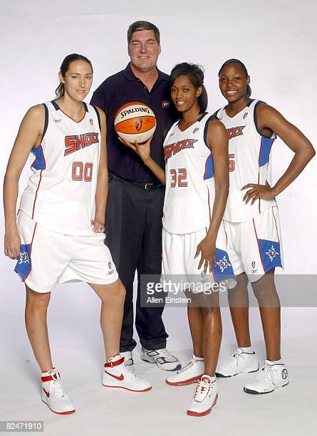 Ruth Riley Head Coach Bill Laimbeer Swin Cash and Cheryl Ford of the Detroit Shock pose during Media Day April 26 2004 at the Palace of Auburn Hills...