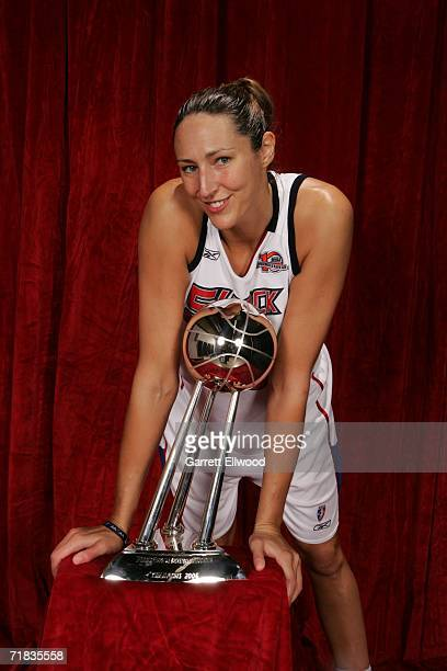 Ruth Riley of the 2006 WNBA Champion Detroit Shock celebrates with the WNBA Championship trophy after winning Game Five of the WNBA Finals 80 to 75...