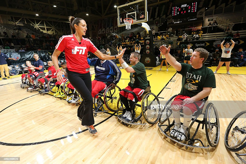 Ruth Riley #00 of the Atlanta Dream greets the West team during the NWBA All-Star Wheelchair Classic at Sprint Arena during the 2014 NBA All-Star Jam Session at the Ernest N. Morial Convention Center on February 13, 2014 in New Orleans, Louisiana.