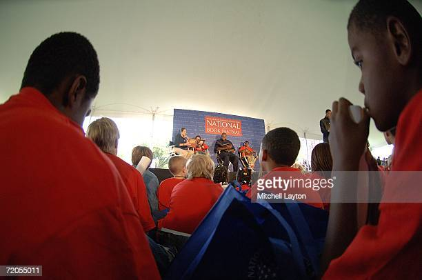 Ruth Riley of the Detroit Shock Brendan Haywood of the Washington Wizards and former Chicago Bull BJ Armstrong read to kids during the National Book...