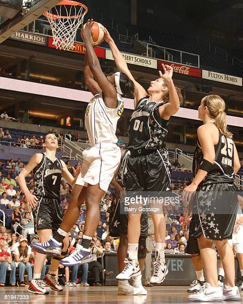 Ruth Riley of the San Antonio Silver Stars blocks the shoot of Barbara Farris of the Phoenix Mercury on July 15 at US Airways Center in Phoenix...