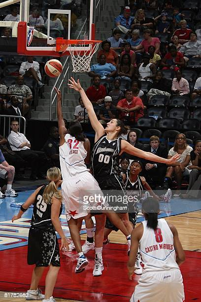 Ruth Riley of the San Antonio Silver Stars challenges the shot by Stacey Lovelace of the Atlanta Dream during the WNBA game on June 18 2008 at...