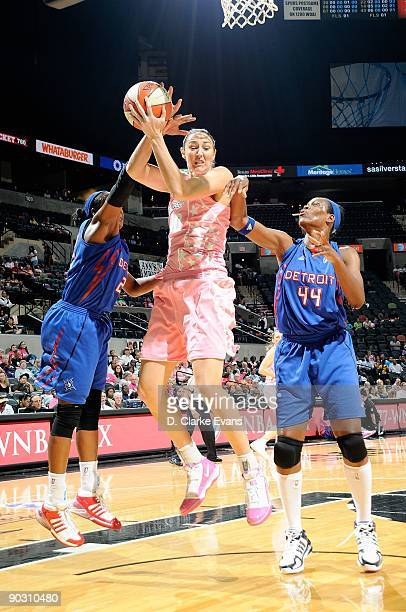 Ruth Riley of the San Antonio Silver Stars comes down with a rebound over Alexis Hornbuckle and Taj McWilliams of the Detroit Shock during the WNBA...