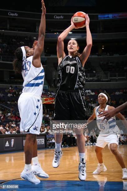 Ruth Riley of the San Antonio Silver Stars shoots against Nakia Sanford of the Washington Mystics at the Verizon Center on July 6 2008 in Washington...