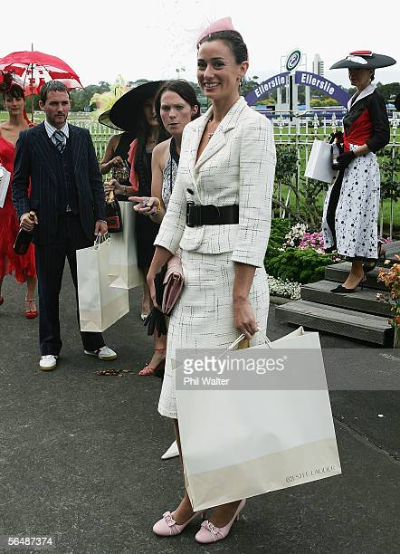 Ruth Sibald winner of Fashion in the Field poses for photographers during day one of the Summer Racing Carnival at the Ellerslie Racecourse December...