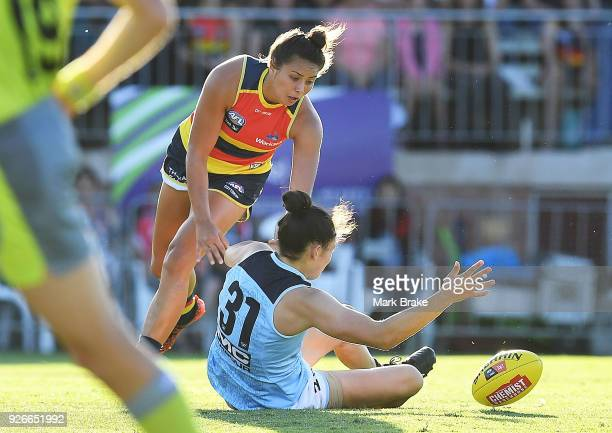Ruth Wallace of the Adelaide Crows and Danielle Hardiman of Carlton during the round five AFLW match between the Adelaide Crows and the Carlton Blues...