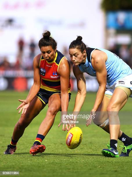 Ruth Wallace of the Adelaide Crows and Katherine Gillespie-Jones of Carlton compete ffor the ball during the round five AFLW match between the...