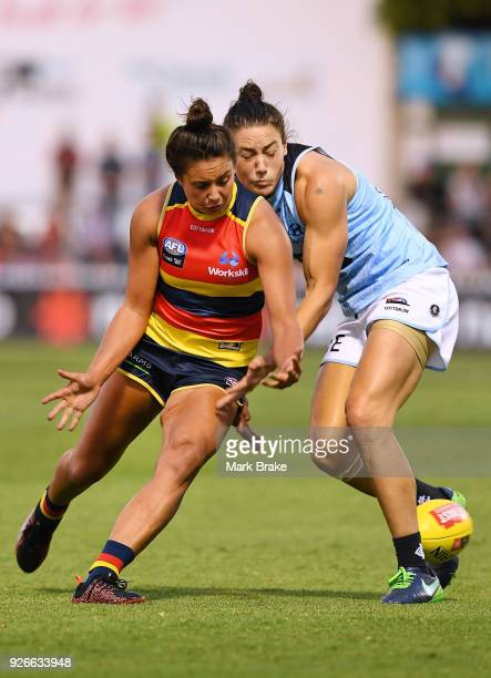 Ruth Wallace of the Adelaide Crows and Katherine GillespieJones of Carlton compete ffor the ball during the round five AFLW match between the...