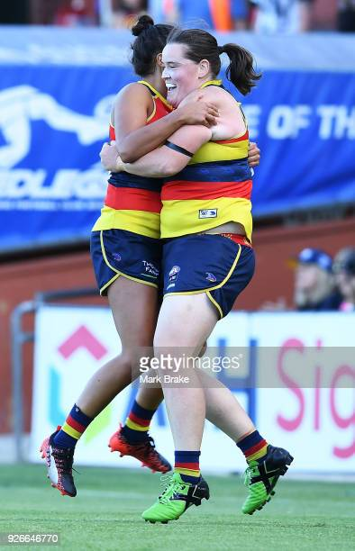 Ruth Wallace of the Adelaide Crows celebrates kicking a goal with Sarah Perkins of the Adelaide Crows during the round five AFLW match between the...