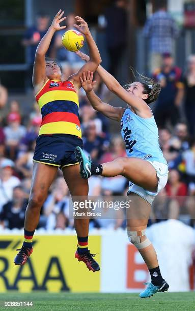 Ruth Wallace of the Adelaide Crows competes for the ball against Katie Loynes of Carlton during the round five AFLW match between the Adelaide Crows...