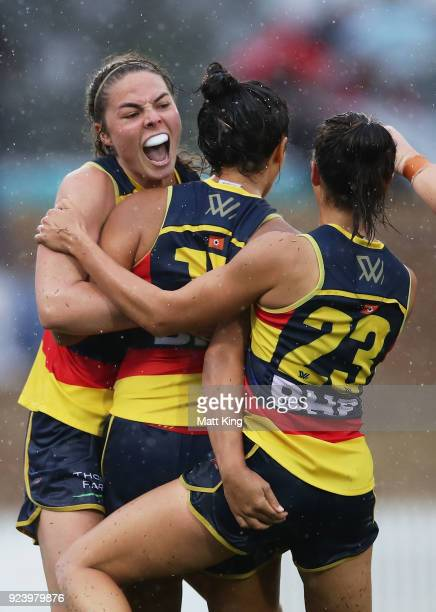 Ruth Wallace of the Crows celebrates with team mates after kicking a goal during the round four AFLW match between the Greater Western Sydney Giants...