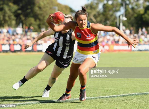 Ruth Wallace of the Crows is tackled by Jess Duffin of the Magpies during the round seven AFLW match between the Collingwood Magpies and the Adelaide...