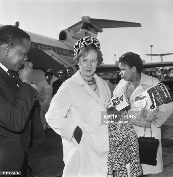 Ruth Williams Khama , the wife of Botswanan President Seretse Khama, UK, 1968. She is reading the book of 'The Dirty Dozen' by EM Nathanson.