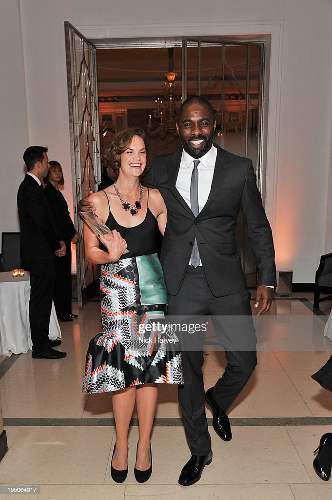 Ruth Wilson and Idris Elba attend the Harper's Bazaar Woman of the Year Awards at Claridge's Hotel on October 31, 2012 in London, England.