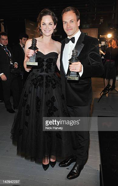 Ruth Wilson winner of Best Actress and Johnny Lee Miller winner of Best Actor poses in the Olivier Awards 2012 press room at The Royal Opera House on...