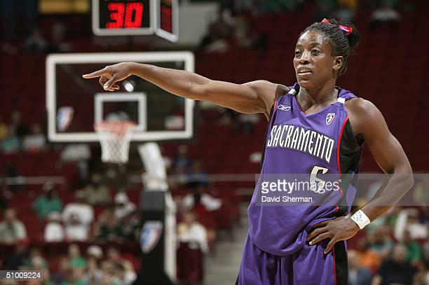 Ruthie Bolton of the Sacramento Monarchs points during the game against the Minnesota Lynx at the Target Center on June 17 2004 in Minneapolis...