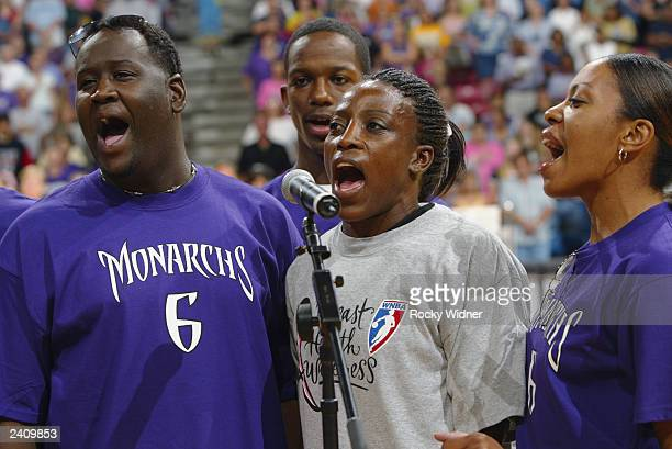 Ruthie Bolton of the Sacramento Monarchs sings during a break in the game between the Monarchs and the Minnesota Lynx on August 9 2003 at ARCO Arena...