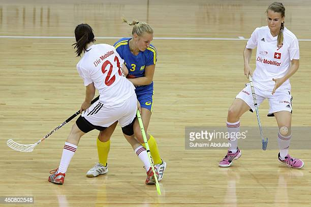 Ruthstrom Olivia of Sweden and Fabienne Riner of Switzerland challenge for the ball during the World University Championship Floorball match between...
